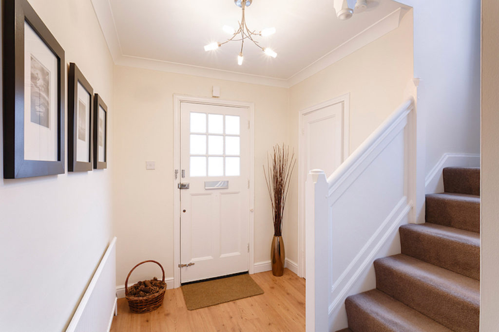 photo - Home interior showing hallway and carpeted stairs