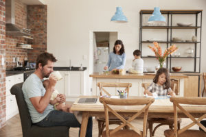 Photo Busy Family Home With Father Working As Mother Prepares Meal